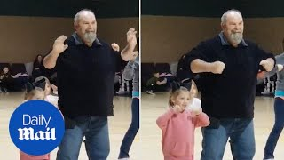 Heartfelt moment grandpa does Chicken Dance with granddaughter