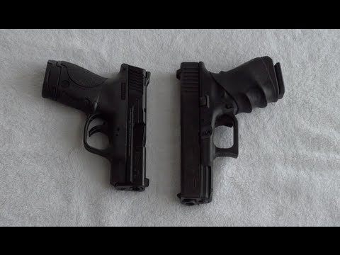 Gun Glock 23 .40 cal size compared to S&W Smith Wesson M&P Shield 9mm Pistol Handgun