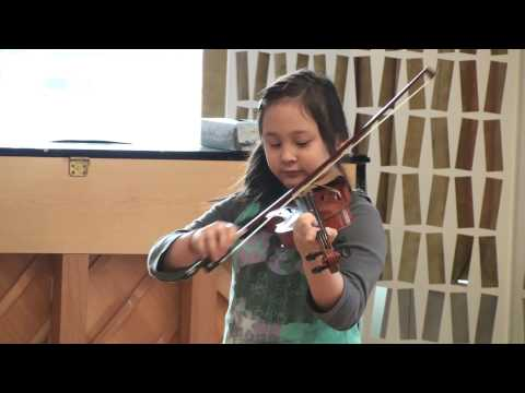 Alessia plays the violin at the Gateway School, New York Dec.2, 2009