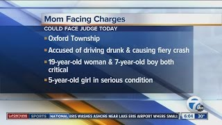 Mom accused of drunk driving, causing crash with her kids in car