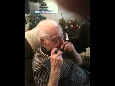 Franny Beecher Playing Harmonica