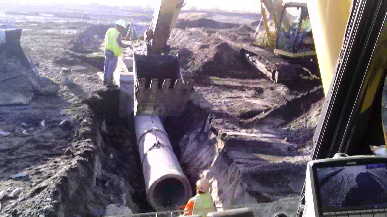 Laying Reinforced Concrete Pipe Rcp W Trackhoe Youtube