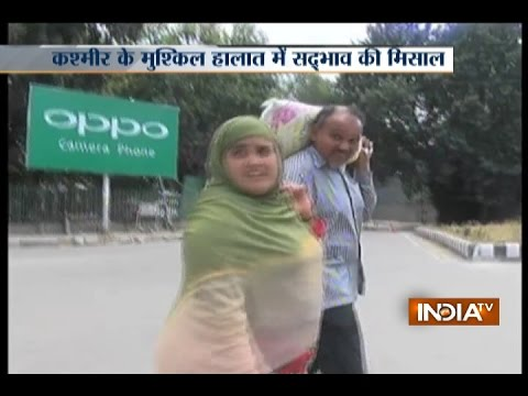 Muslim woman helps his Kashmiri Pandit friend with food in violence-hit Jammu and Kashmir