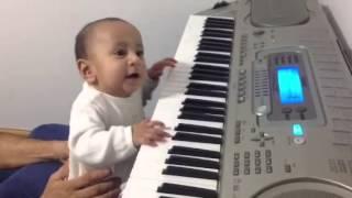 Baby playing keyboard