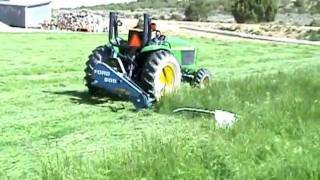JOHN DEERE 4300 CUTTING GRASS WITH FORD 505 SICKLE MOWER