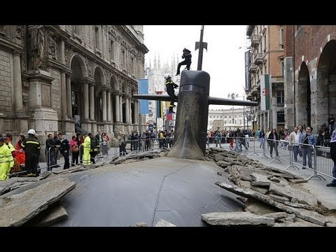 Incredible moment submarine breaks the surface of a Milan STREET...