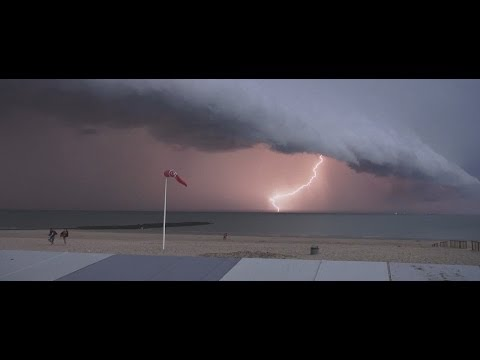 "Storm ""Arcus"" over the north sea in Belgium, Knokke-Le-Zoute, 05/08/2013.The cloud that we see is a arcus. According to specialists of MRI, these clouds, whi..."