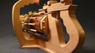 Up Close and Personal --- RotaryMek-12X Rubber Band Gun.wmv