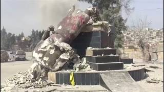 Turkey-backed forces pull down Kurdish statue in Afrin town centre