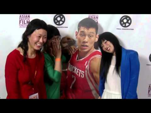 Linsanity...pretty Asian Girls pose with cardboard cut-out of Basketball star Jeremy Lin!