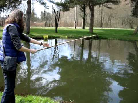 Catching big rainbow trout in a pond