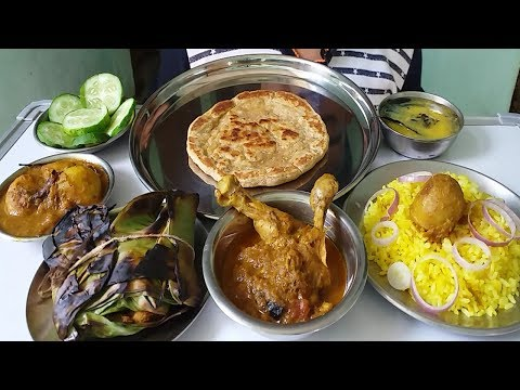 eating chicken paturi and chicken curry with paratha and fried rice (spicy food)