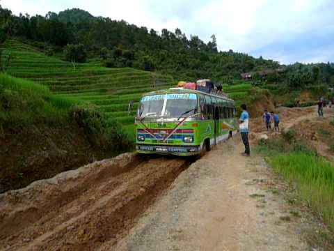 TATA Power! TATA Bus traverses a muddy dirt road in Nepal