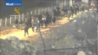 Migrants attempt to storm border fence at Spanish enclave