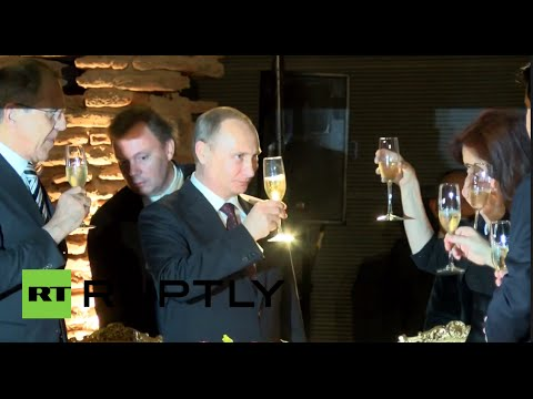 Chin Chin! Putin drinks champagne with presidents of Argentina and Uruguay