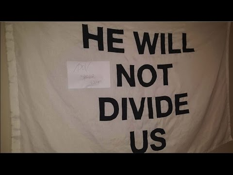 Watch someone steal Shia Labeouf's He will Not Divide US flag and replaces it with MAGA hat