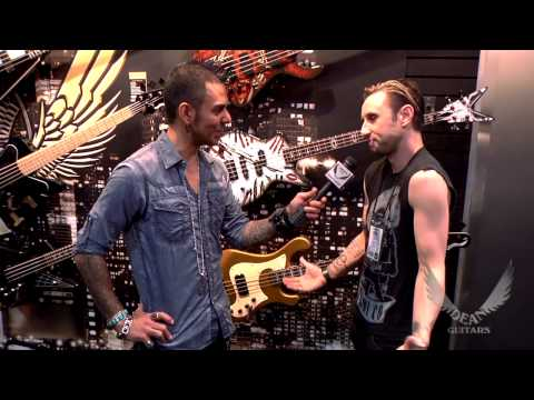 Dean Guitars Artist Eric Bass of Shinedown shows off his signature Dean bass at 2013 NAMM.