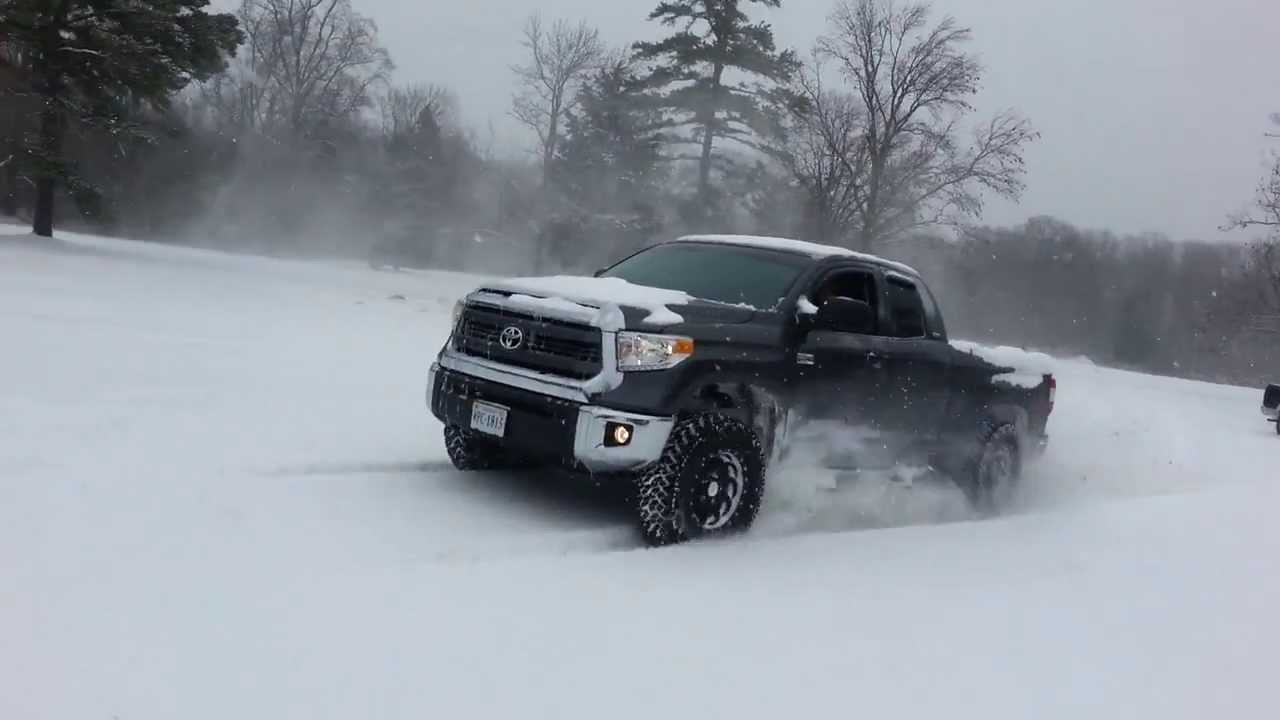 2014 Chevy Tahoe >> 2014 Toyota Tundra vs Chevy Tahoe - Dig race in the snow - YouTube