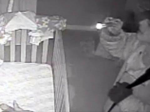 Burglar stares at sleeping infant -- caught on tape