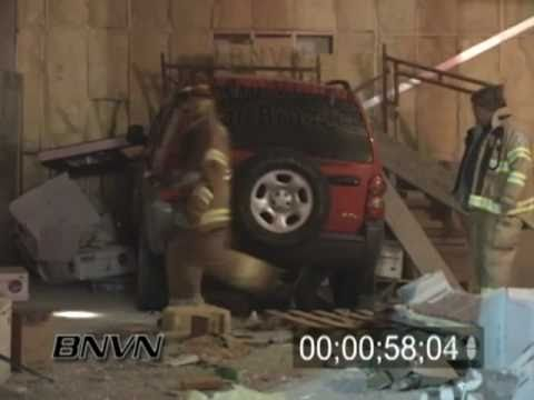 12/05/2006 Aftermath of a SUV that crashed into a strip mall under construction