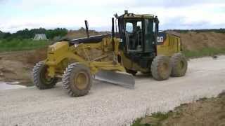 CAT 140M spreading gravel part 1