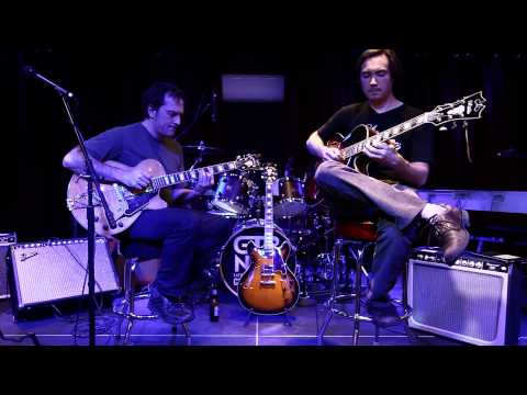 D'Angelico rep Andrew and D'Angelico artist Larry Jamming on stage at GTRstore