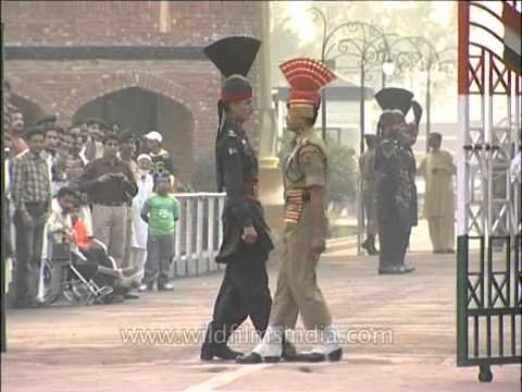 Indian soldier and Pakistan soldier gave a friendly hand-shake at Wagah Border
