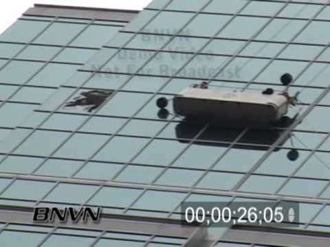 9/23/2004 Windy Weather breaks window cleaners away from high rise building