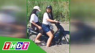 2 cô gái đi xe máy lao thẳng vào đường đang đổ bê tông | THDT