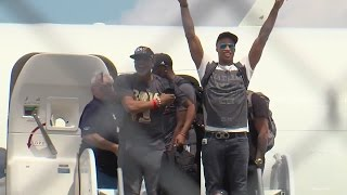 Cavs return home after championship win