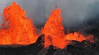 Watch as Hawaii's Kilauea volcano erupts lava