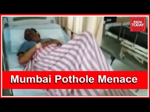 Mumbai Pothole Menace : Biker Suffers Serious Injuries After Bike Hits Pothole