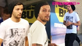 Louis Tomlinson Of One Direction Steals A Pap