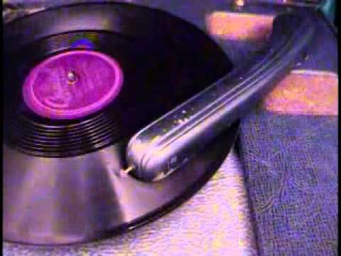 Nat King Cole (swing jazz) on 78 rpm record player phonograph
