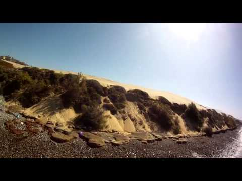 Fast and Low FPV HD flight in Mexico.  Crazy flight along beach and inside power lines !