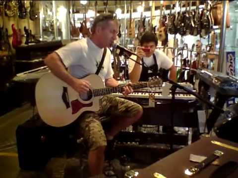 Trev Newman 'Jamming' and annoying the staff in Bangkok Music Store
