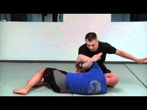 How to Perfect Your Armbar: The 180 Armbar Drill Image 1