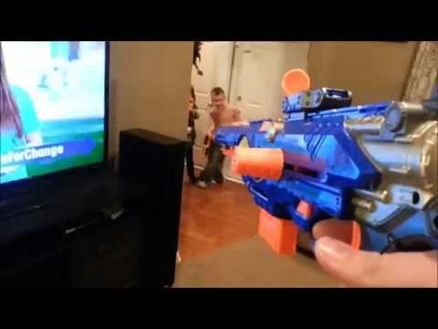 Daddy and Kids Playing Nerf Guns