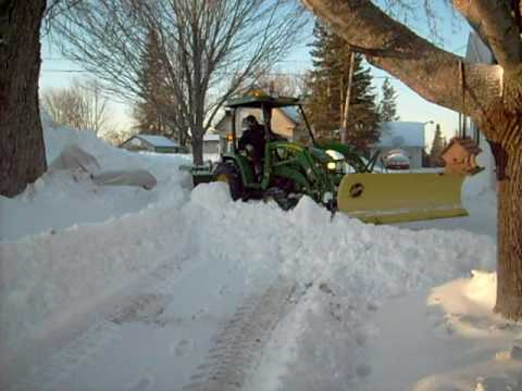 Snow Plowing John Deere with Fisher Plow