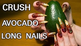 Long nails crush green avocado