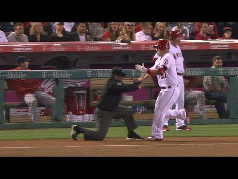 Trout knocks over umpire going to first