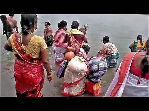 Village women & child are river bathing on Sankranti (festival) thumbnail