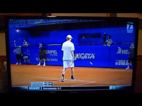 Dmitry Tursunov slams a ball into a lines judge head