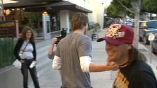Paris Hiltons Alex Vaggo with woman on Robertson.