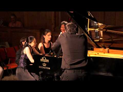 4 pianists and one grand piano