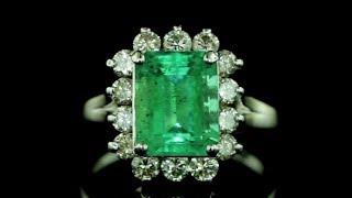 4.35ctw Emerald Cut Emerald diamond halo 14kt gold ring