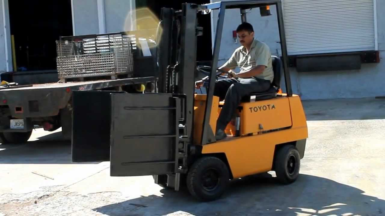 toyota sit down clamp truck with long reach mfg squeeze