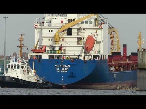 cargo crane seaship MICHIGAN V2EK5 IMO 9501241 leaves Emden dock area tug assisted timelapse