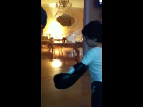 Boxing his dad!