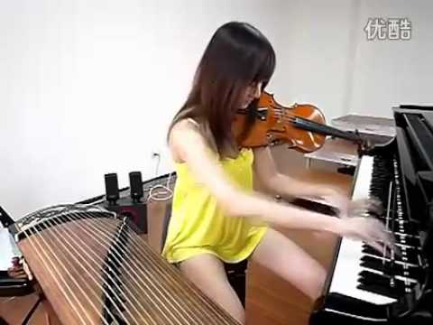 A Beautiful Chinese girl Play WUNIANG with 3 instruments at the same time